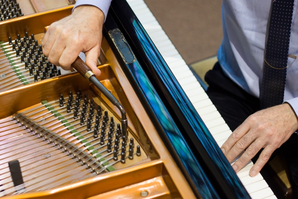 Piano being tuned