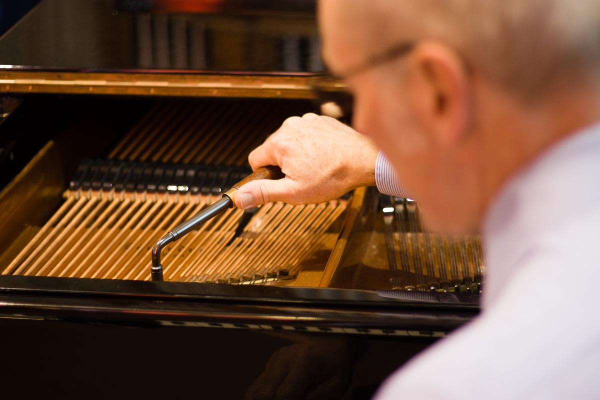 Paul Fox tuning a piano